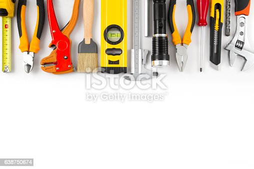 Different kind of construction tools on white background with copy space.