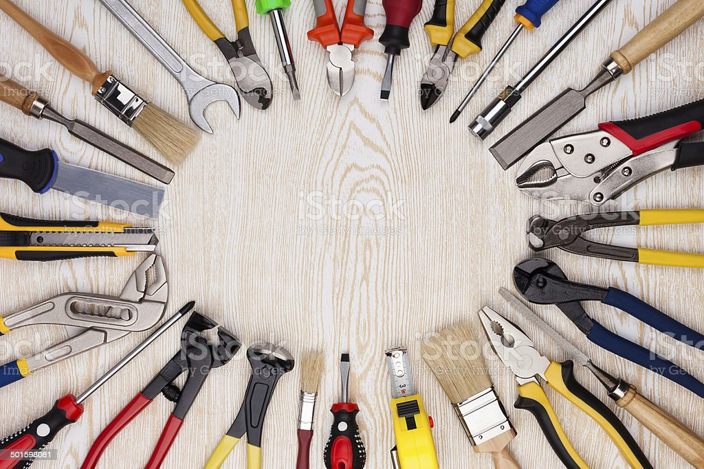 Work tools on wooden texture. royalty-free stock photo