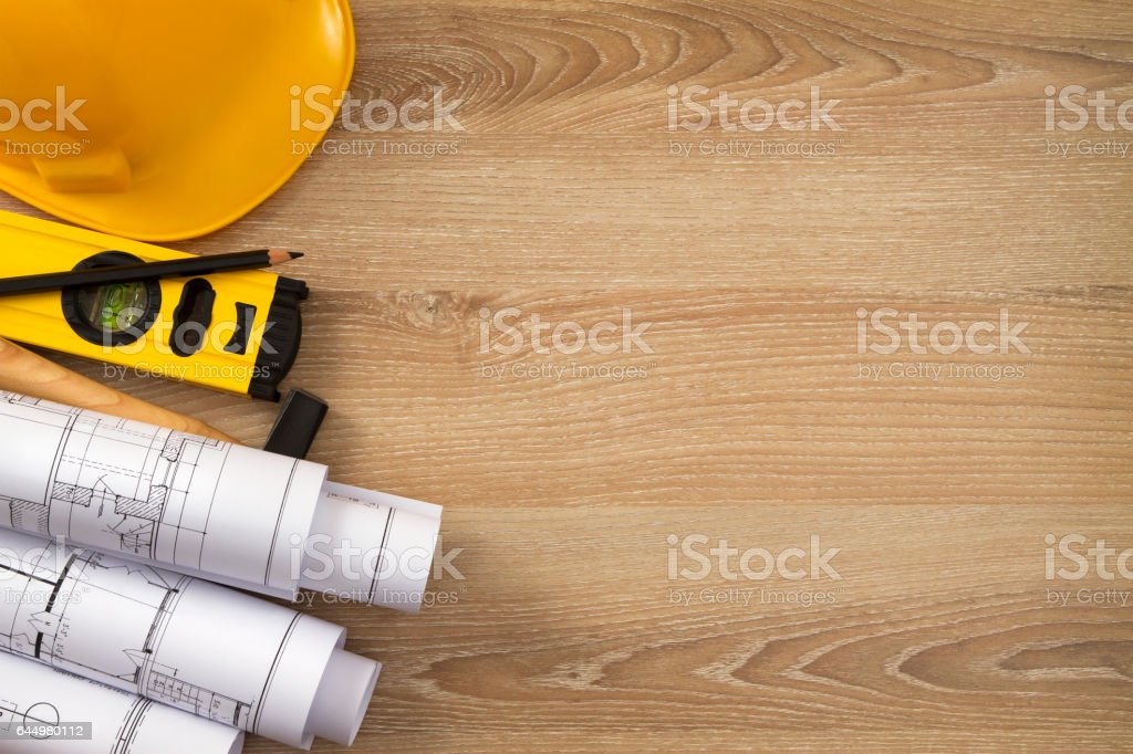 Work Tools with Blueprints on Wooden Table stock photo
