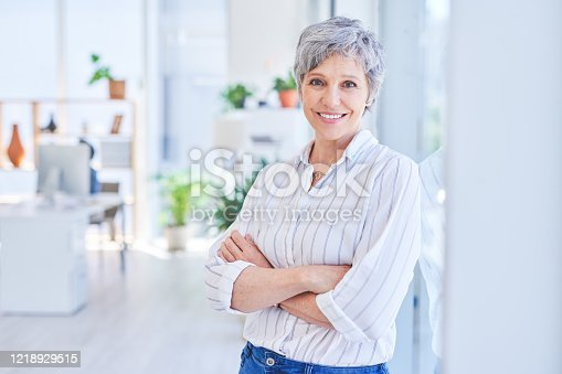 Portrait of a mature businesswoman standing in an office