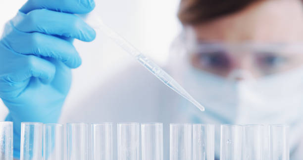 Work with caution when handling samples Closeup shot of a scientist working with medical samples in a lab laboratory glassware stock pictures, royalty-free photos & images
