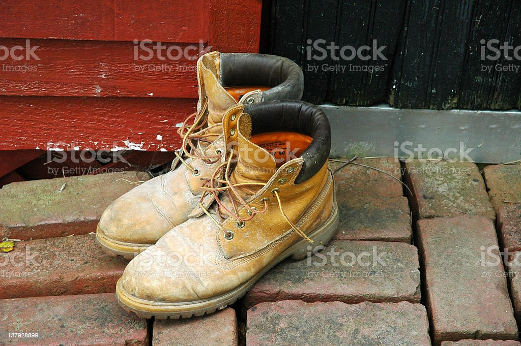 Workboots outside the door stock photo
