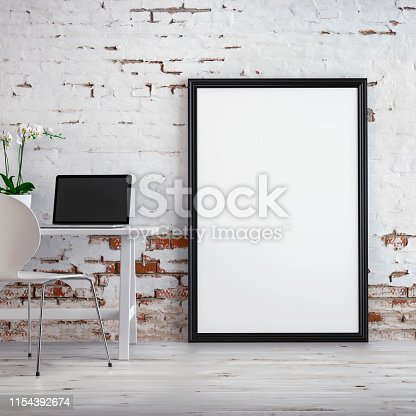 Workdesk with decoration and a picture frame on hardwood floor in front of empty white brick ruined wall with copy space. 3D rendered image.