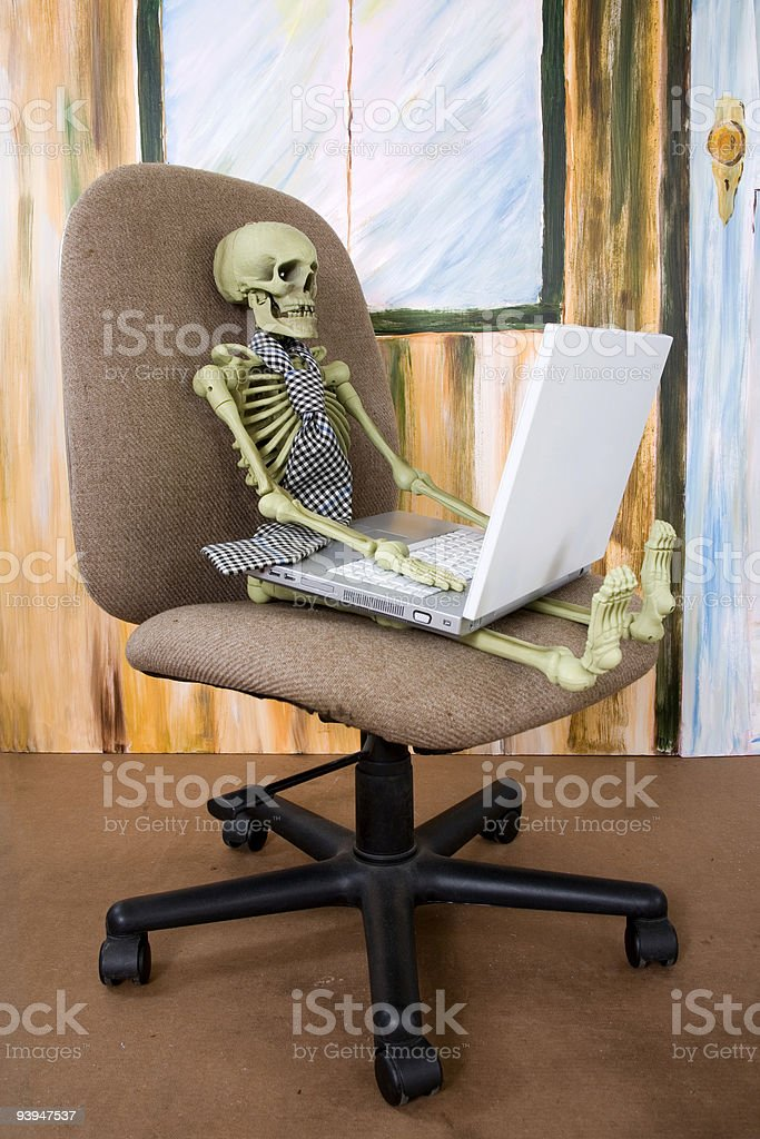 Worked To Death Skeleton In Office Chair With Computer
