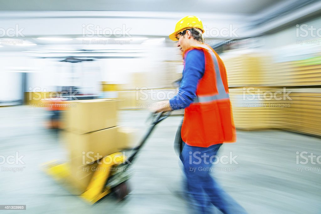 Worker and female manager in busy warehouse speedy working action stock photo
