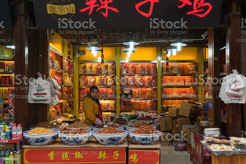 Worker and hot pepper shop on local street in China stock photo
