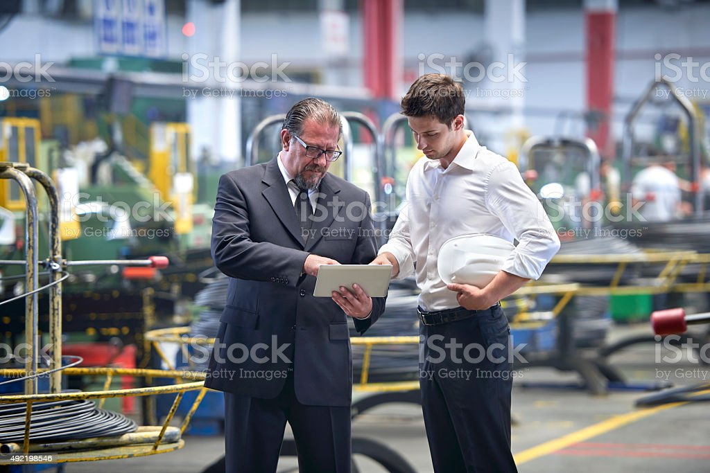 Worker and manager meeting in factory stock photo