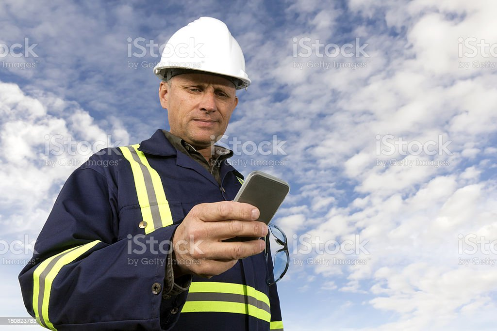 Worker and Smartphone royalty-free stock photo