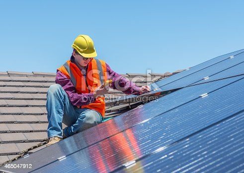 istock worker and solar panels 465047912