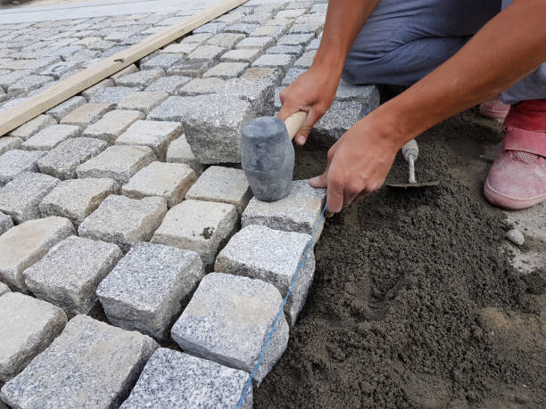 Worker Arranging a Pavement stock photo