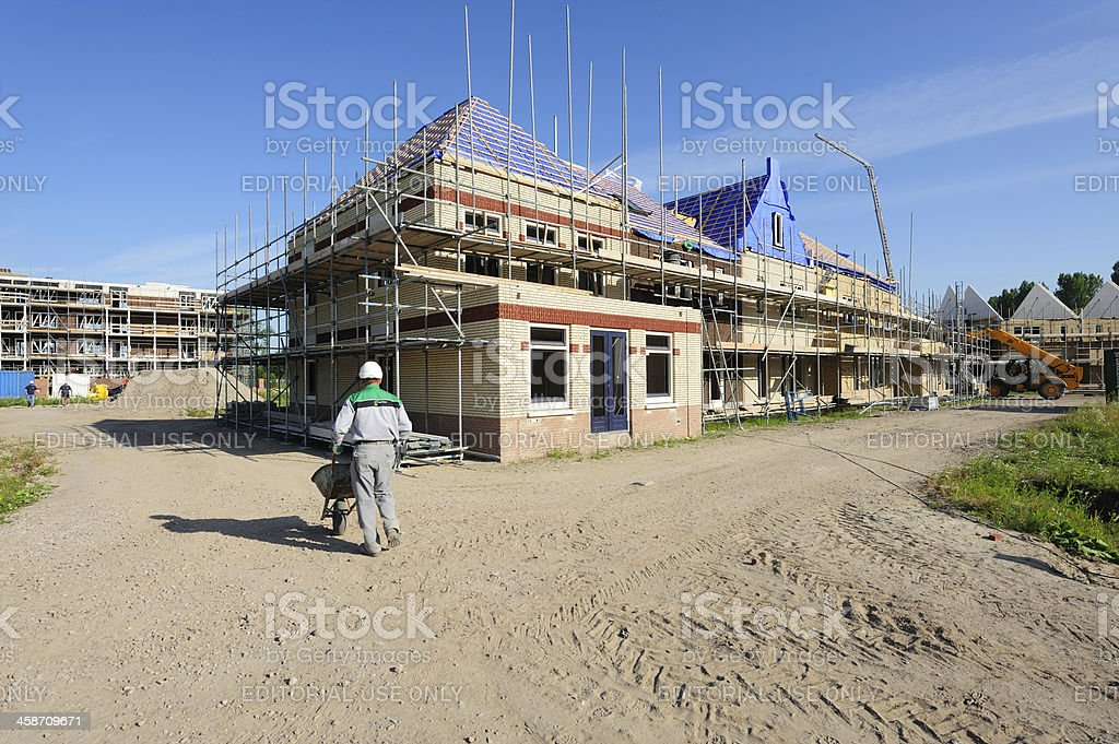 Worker at a housing construction site stock photo