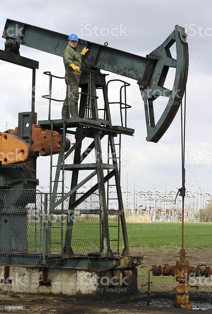 worker at an oil field royalty-free stock photo