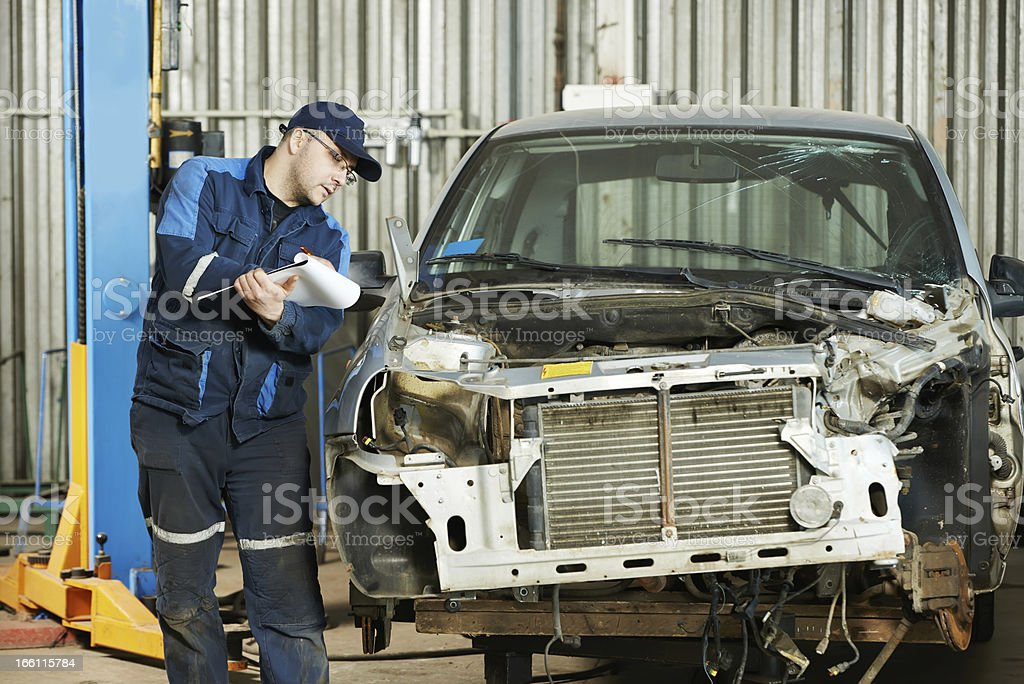 worker at car repair determination royalty-free stock photo
