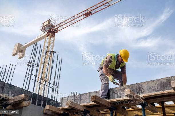 Worker at construction site is fixing the form for the beam picture id897664288?b=1&k=6&m=897664288&s=612x612&h=x1tuu3xzvp5pj d1 unyxlkyejjorpdjr6wtiderts0=
