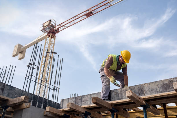 Worker At Construction Site Is Fixing The Form For The Beam stock photo
