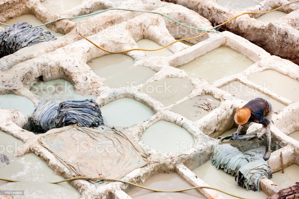Worker at Fez Medina Tannery Fes, Morocco royalty-free stock photo