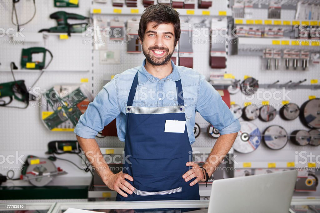 Worker at  hardware store stock photo