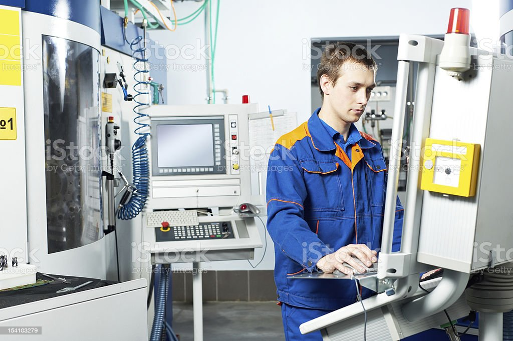 worker at machine tool in workshop stock photo