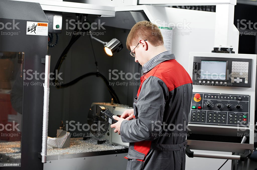 worker at machining tool workshop stock photo