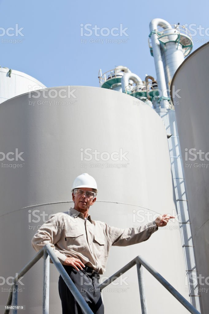 Worker at manufacturing plant giving orders stock photo