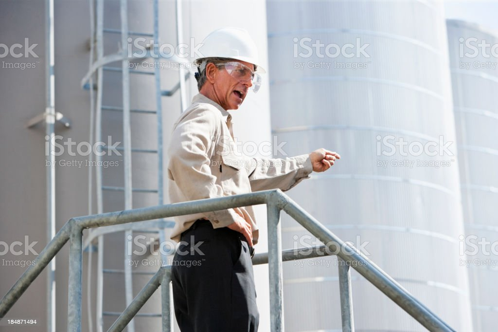 Worker at manufacturing plant stock photo