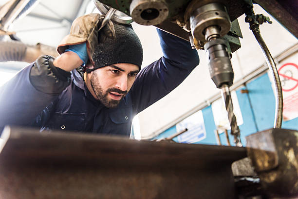 Worker at milling machine in workshop. Worker at milling machine in workshop. metal worker stock pictures, royalty-free photos & images