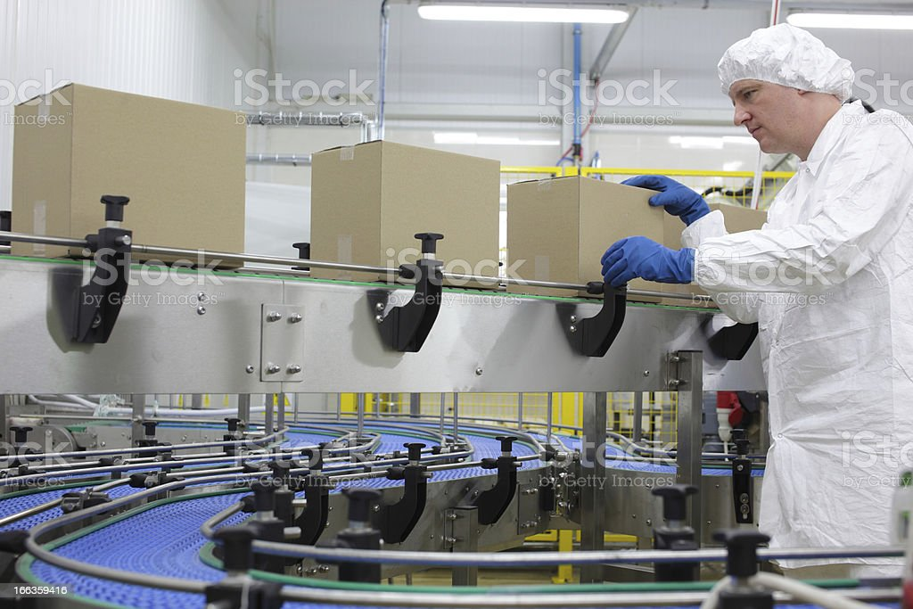 worker  at packing line in factory stock photo