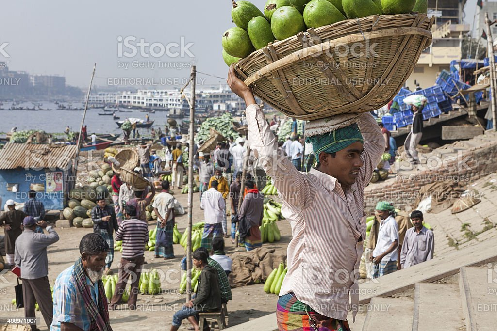 Worker at vegetable market in Bangladesh stock photo