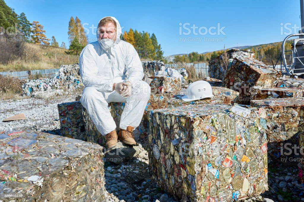 Worker at Waste Processing Plant stock photo