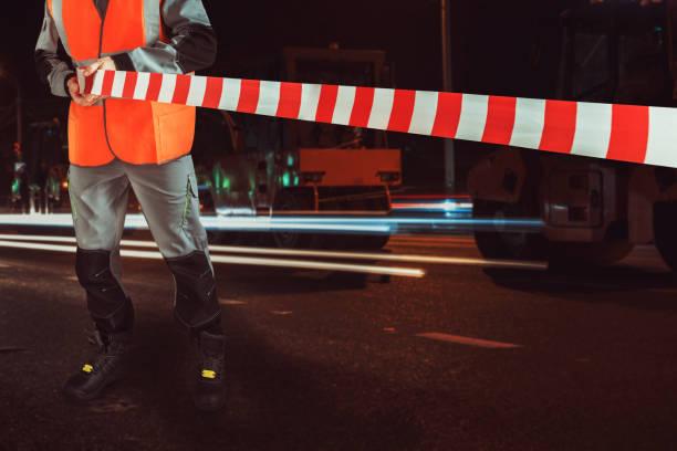 Arbeiter blockiert Reparaturstraße – Foto