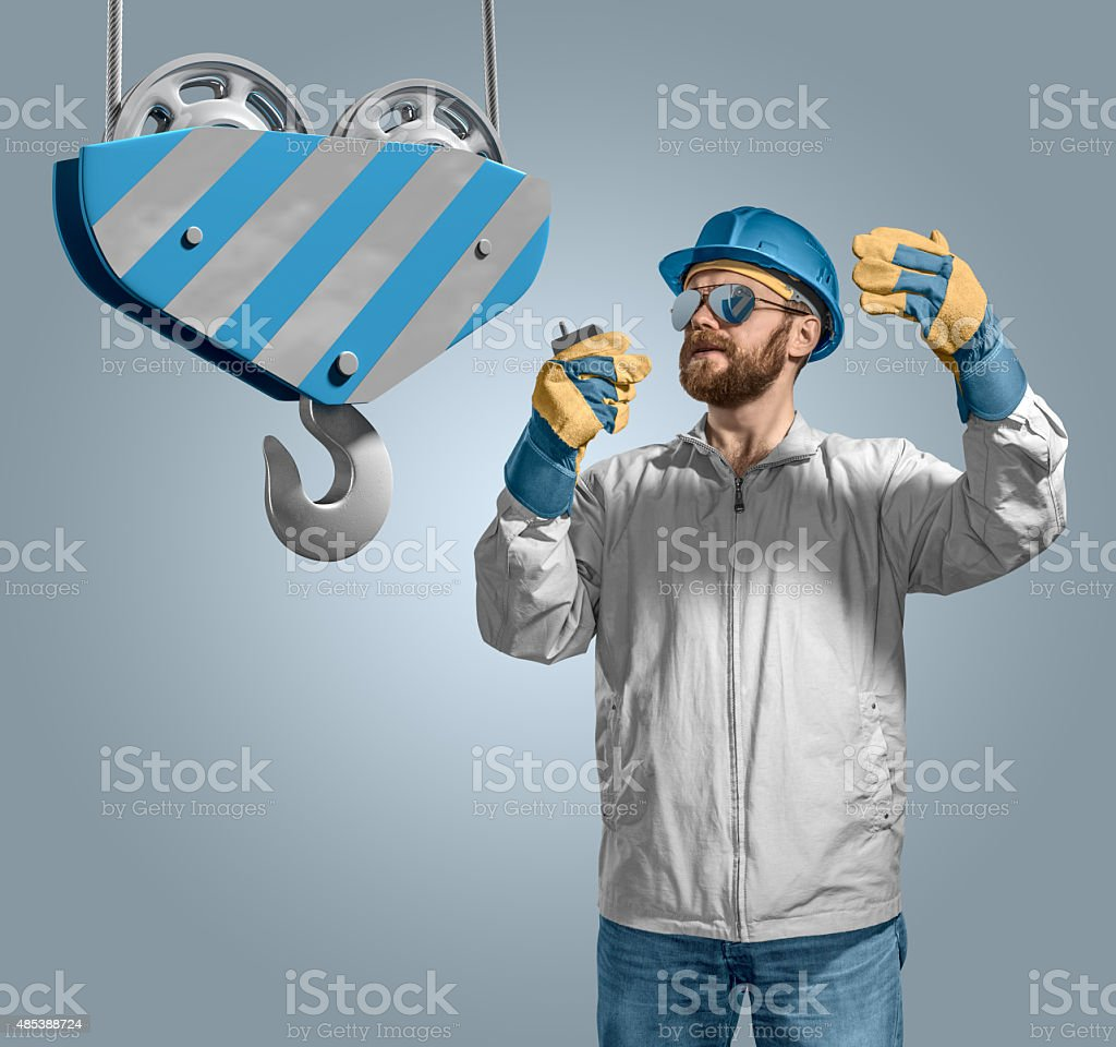 worker builder manages construction process, crane hook stock photo