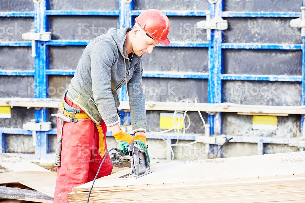 worker carpenter joiner at building site stock photo
