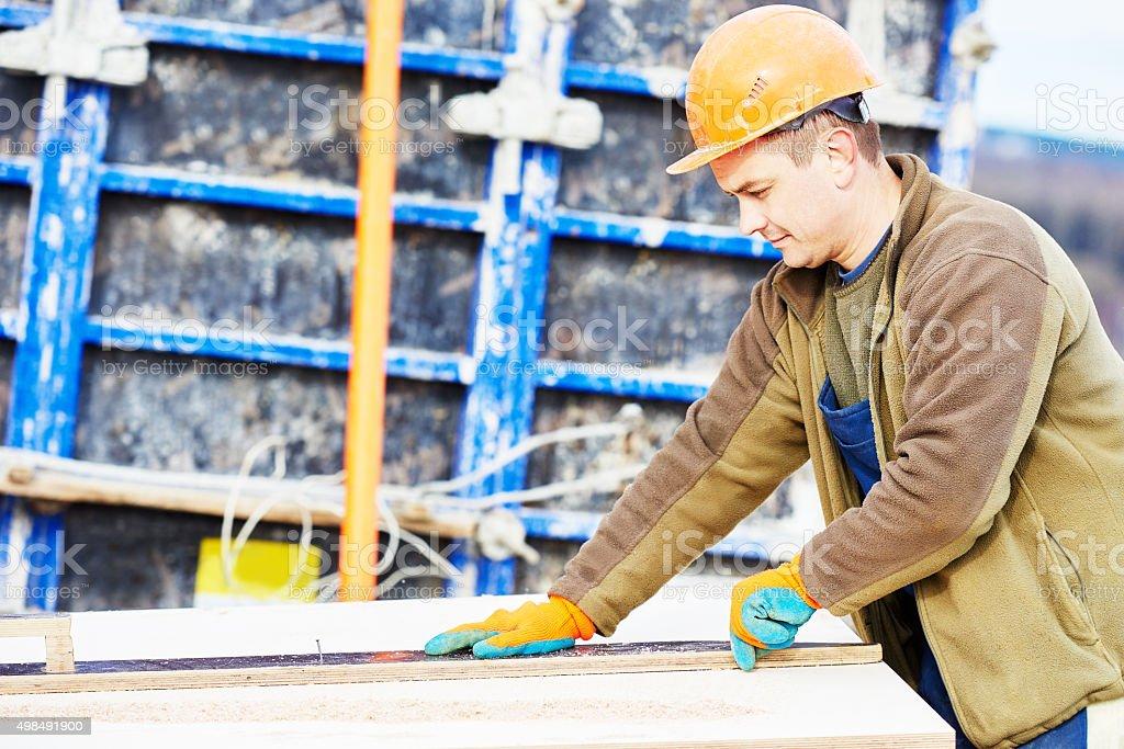 worker carpenter preparing construction formwork for concreting stock photo