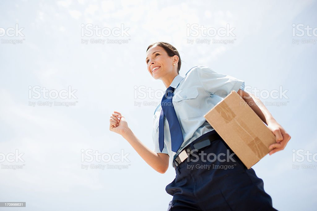 Worker carrying box stock photo