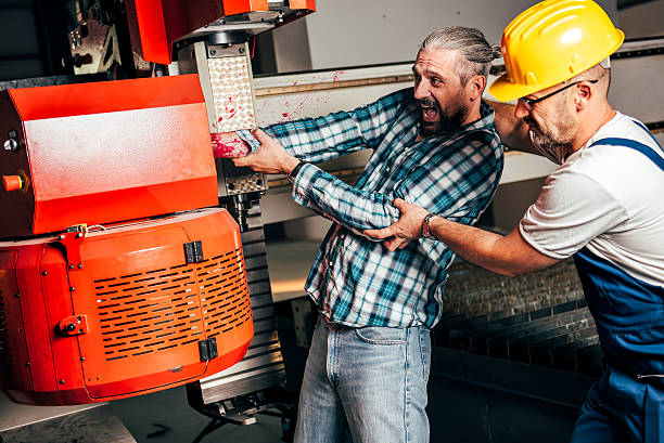 Worker caught in the machine and seriously injured stock photo