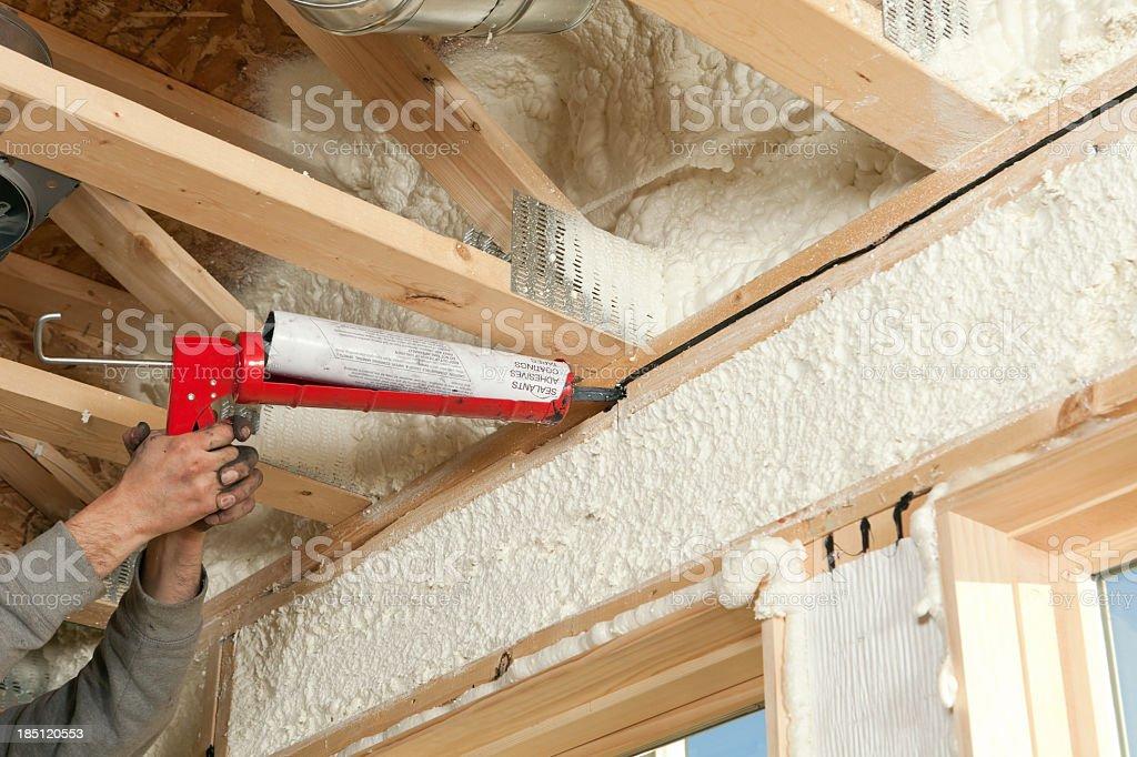 Worker Caulking Window Header stock photo