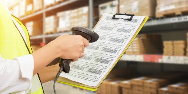 Worker checking and scanning package by laser barcode scanner stock photo