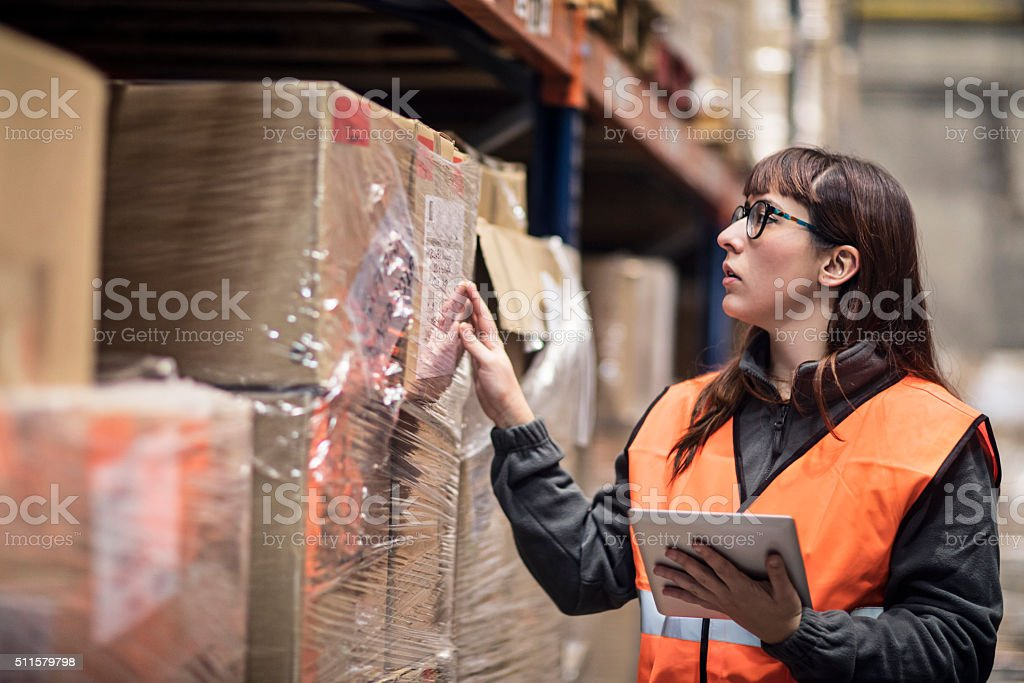 Worker checking box in warehouse stock photo