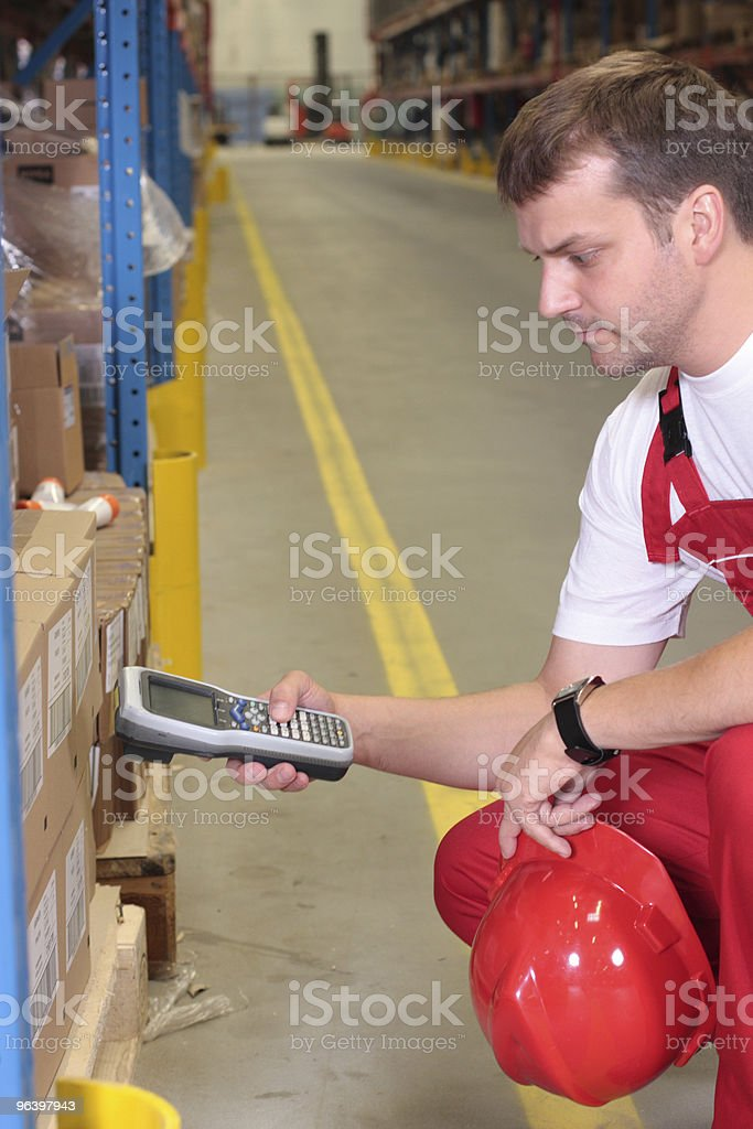 worker checking code in factory - Royalty-free Adult Stock Photo