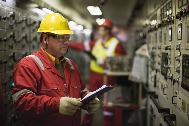 Worker checking machinery  power occupation stock pictures, royalty-free photos & images