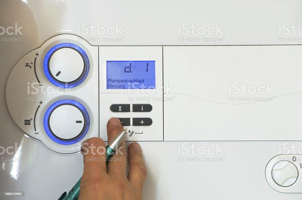 Worker checking on plumber heating machine stock photo