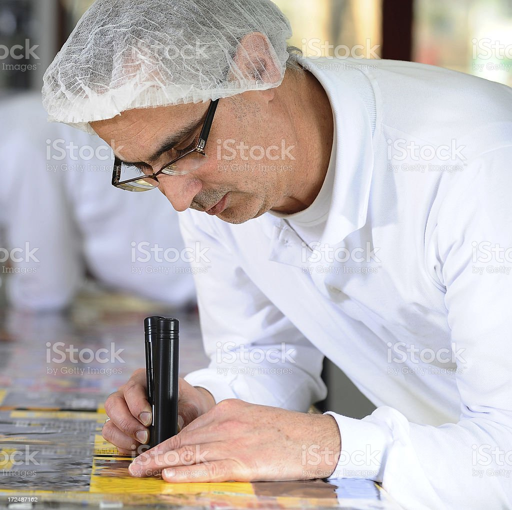 Worker checking the fit in printing plant stock photo