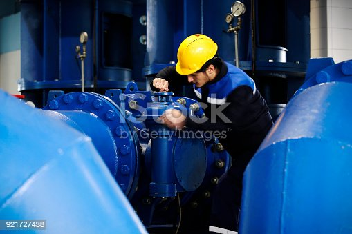 Worker checking the oil pipeline equipment