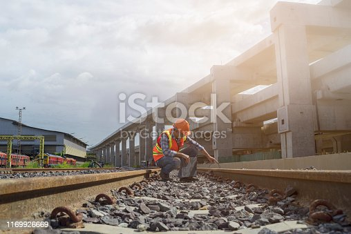 Engineer checking track of railway before  grand opening