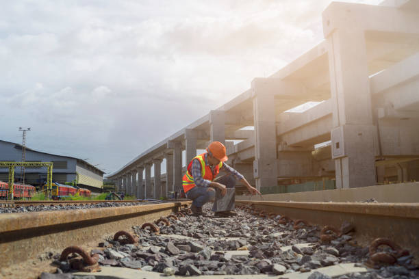 Worker checking track of  mass transit Engineer checking track of railway before  grand opening railway bridge stock pictures, royalty-free photos & images