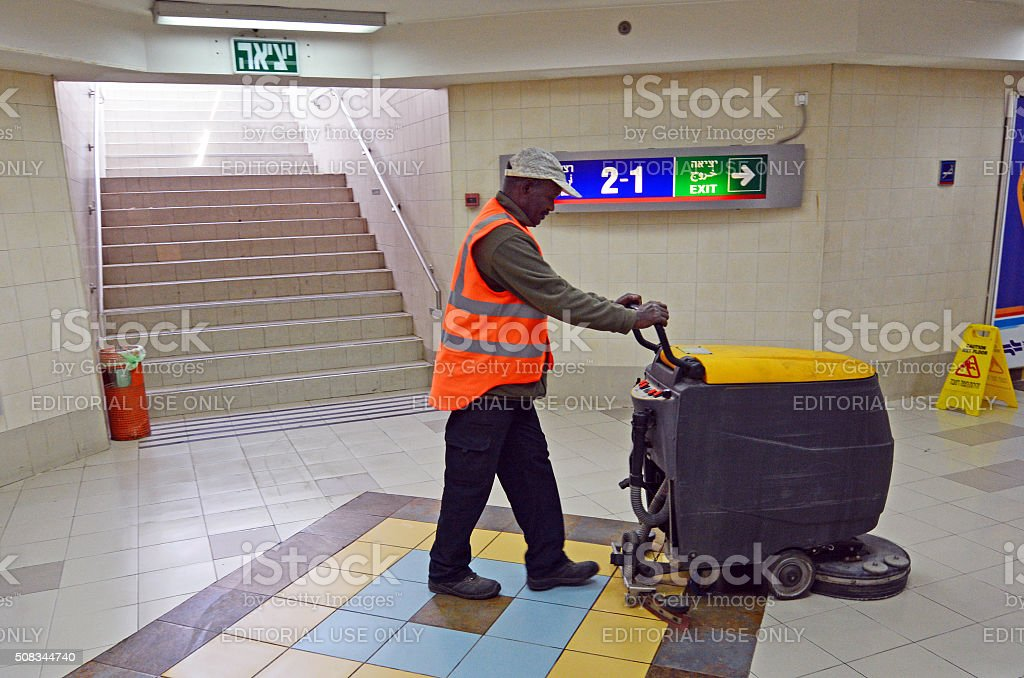 Worker clean floor with cleaning floor scrubber machine stock photo