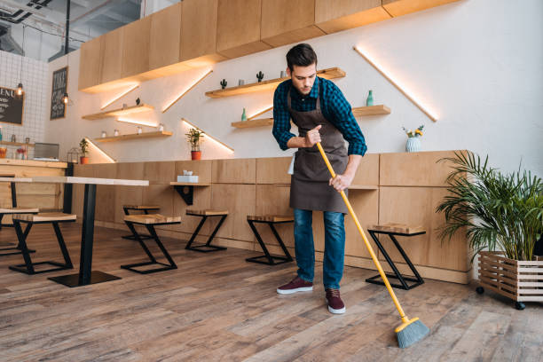 worker cleaning floor with sweep - sweeping stock pictures, royalty-free photos & images