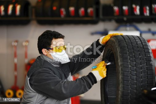 154934986 istock photo Worker cleaning tire 187036962