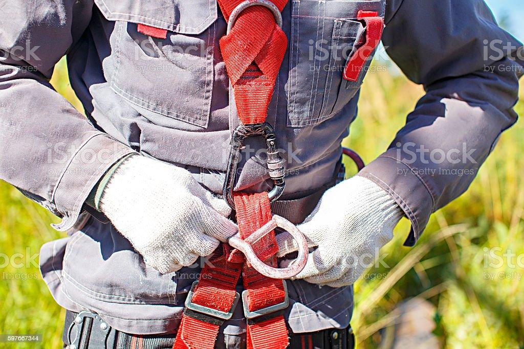 worker climber preparing for steeplejack work stock photo
