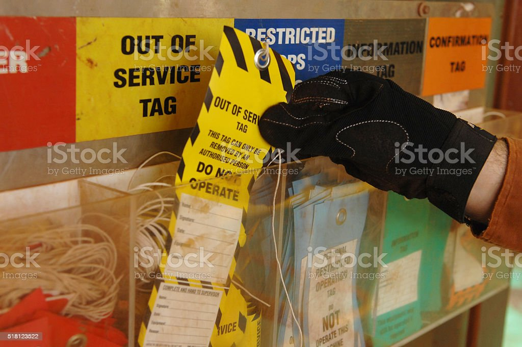 A worker collects an information tag from a safety checkpoint station...